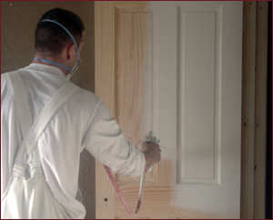 PJM Decorators painting a door